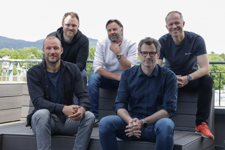 Aksel Lund Svindal, Yngve Tvedt, Erik Syvertsen, Alexander Woxen and Ivar Kroghrud sitting together and smiling