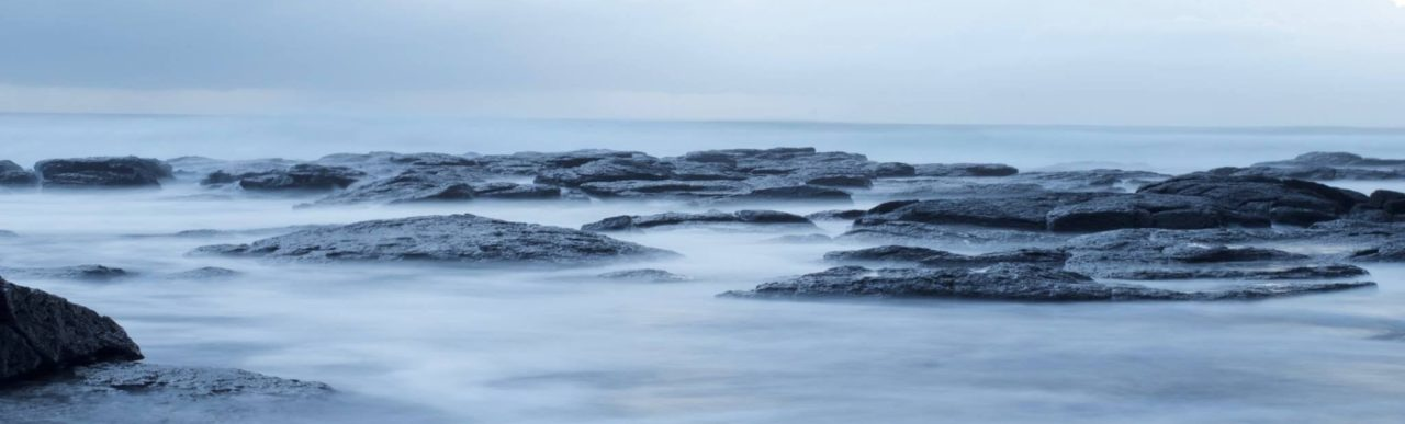 Many flat rocks covered in mist on a cloudy day