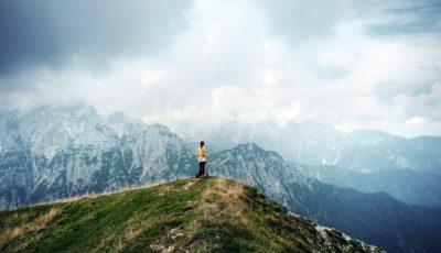 Woman on mountaintop in autumn